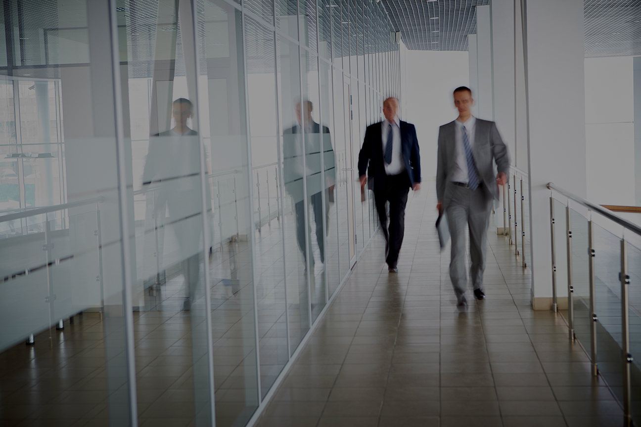 Property managers that use Easy Work Order's work order management system, walking in the office corridor
